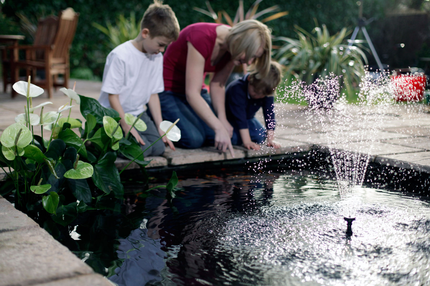 Family with pond fountain
